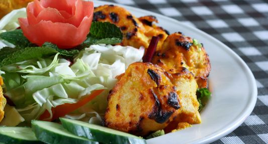 bigstock-chicken-tikka-with-salad-in-pl-152773911